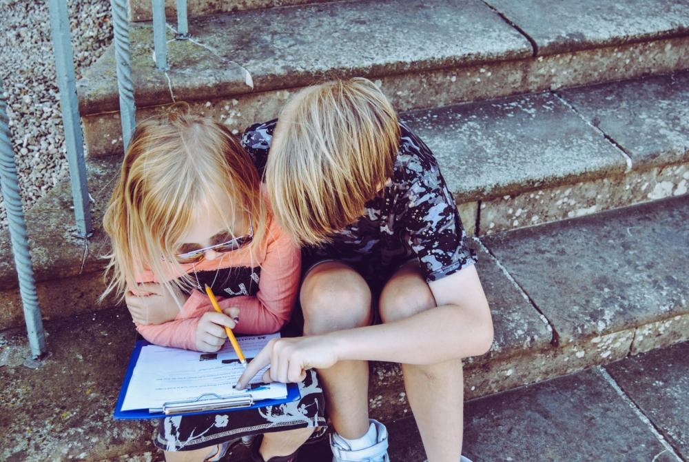 Two children learning on a laptop.