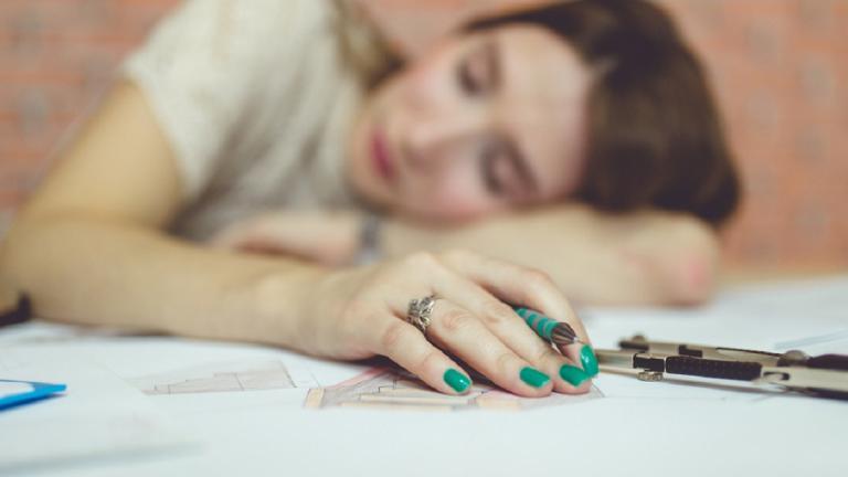 Sleepy woman at work