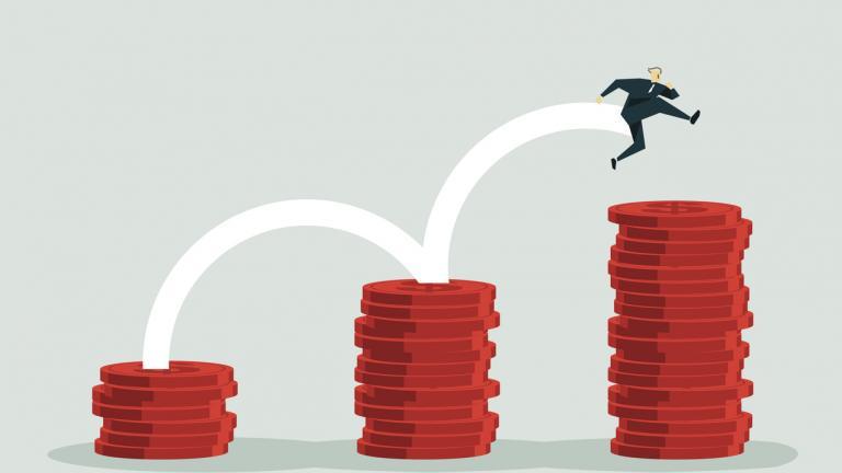 man jumping on piles of money