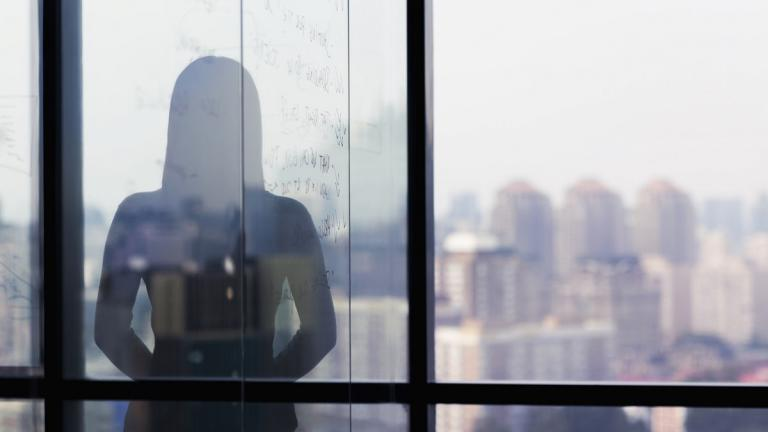 Silhouette of person in office