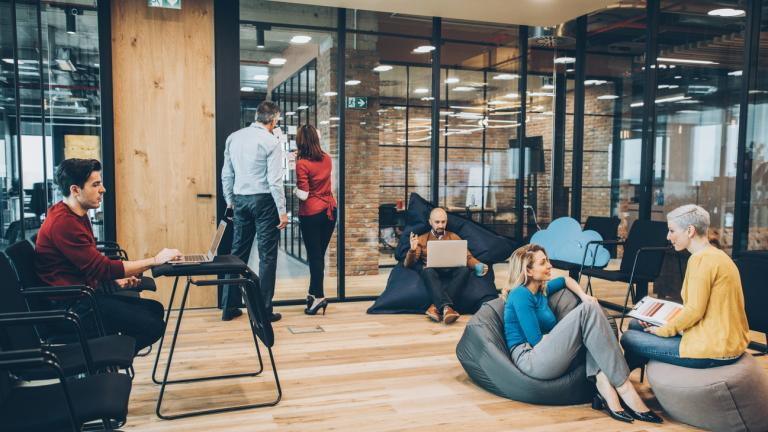 Employees chatting in communal office space