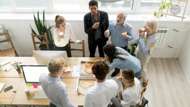 happy workforce eating pizza