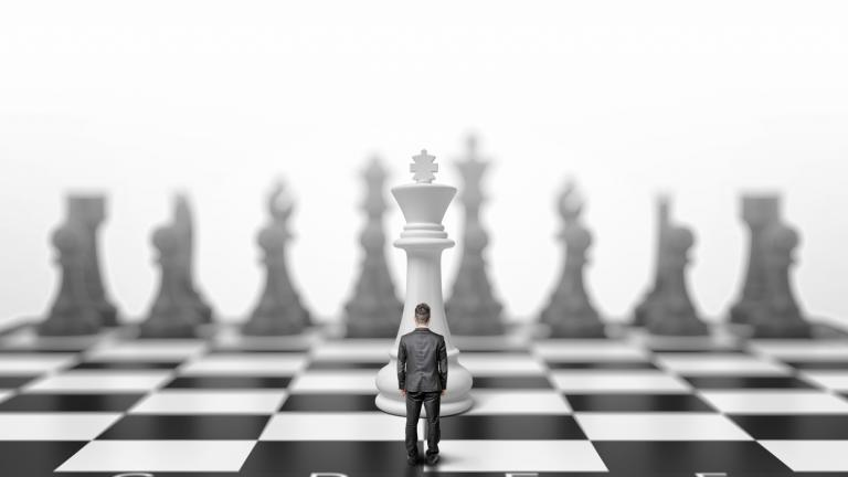 Man standing on chess board