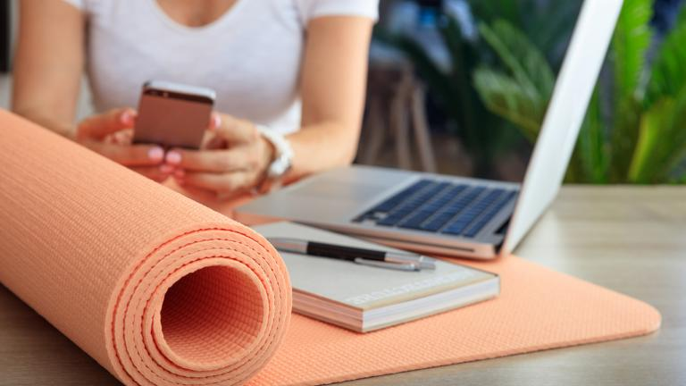 yoga mat on a desk with a laptop