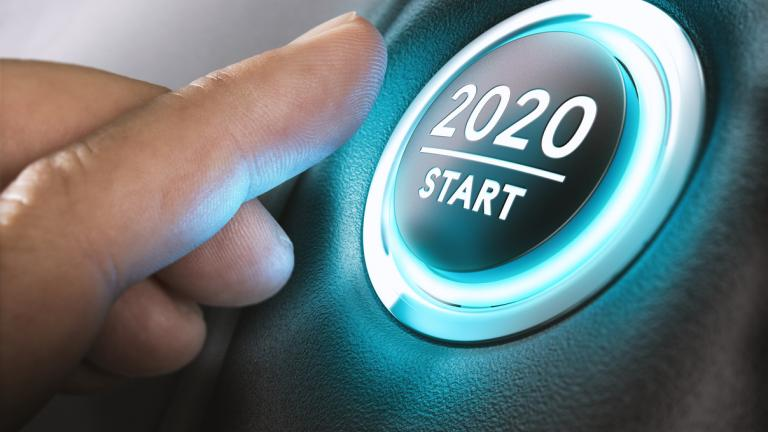 finger pushing a button marked 2020