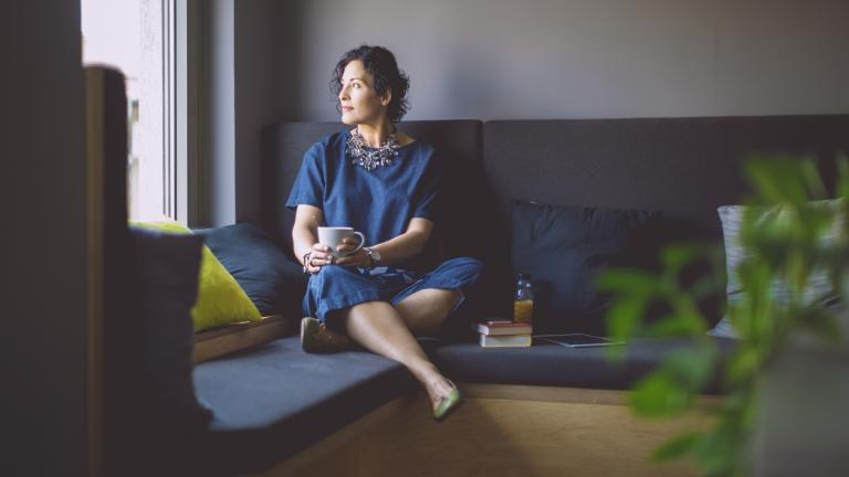 Woman practising mindfulness at home