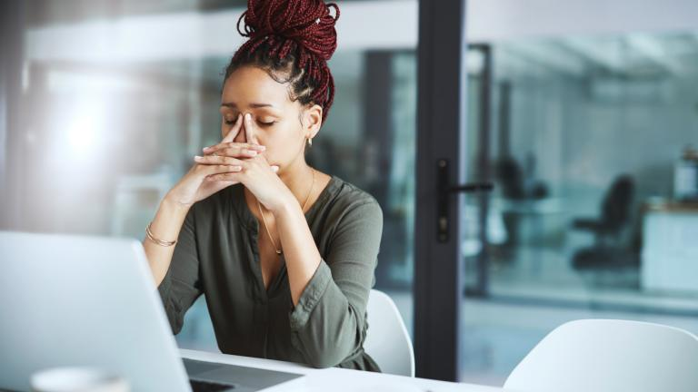 Black business woman stressed at work