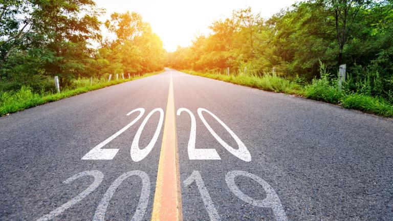 Number 2019, 2020 on empty asphalt road