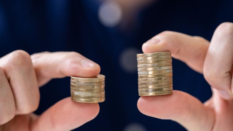 Man Holding Two Coin Stacks