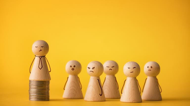 Wooden figures on yellow background. Arrogant leader businessman Concepts