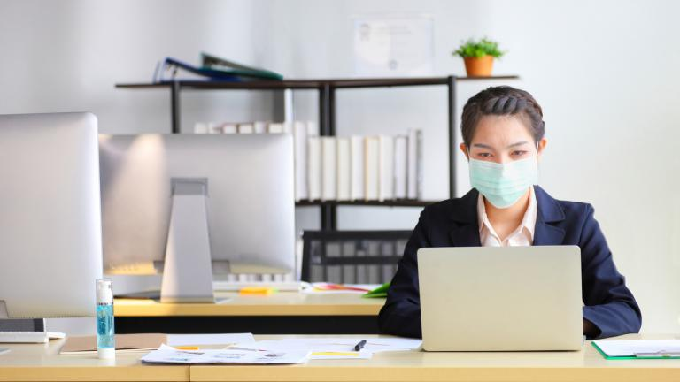 Woman at work wearing face mask