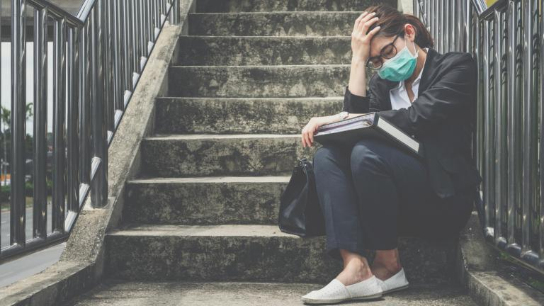 Stressed woman sat on steps