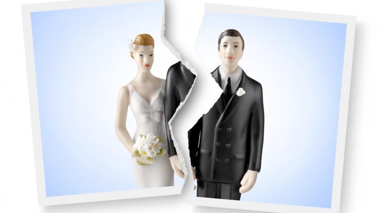 Divorce. Torn photograph of wedding cake topper