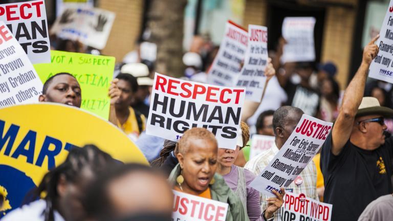 protestors holding signs for justice black lives matter