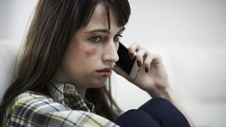 Female Victim Of Domestic Abuse Phoning Support Group