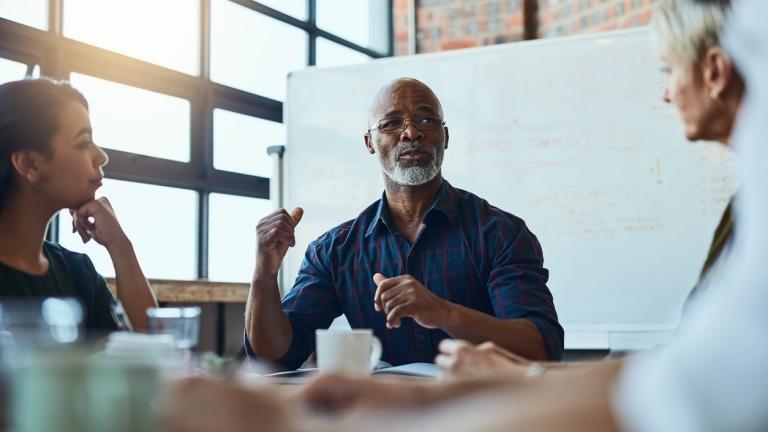 Black leader in business meeting