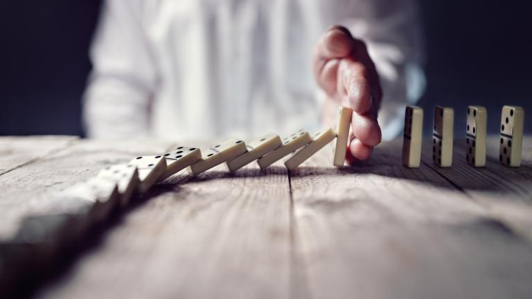 Leader stopping dominoes