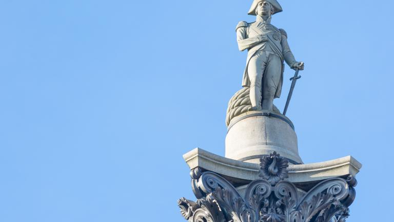 The famous statue of Admiral Nelson on Trafalgar Square in London, UK, on blue clear sky