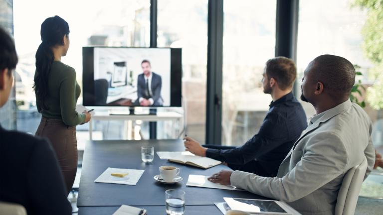 Shot of professional businesspeople sitting in on a video conference