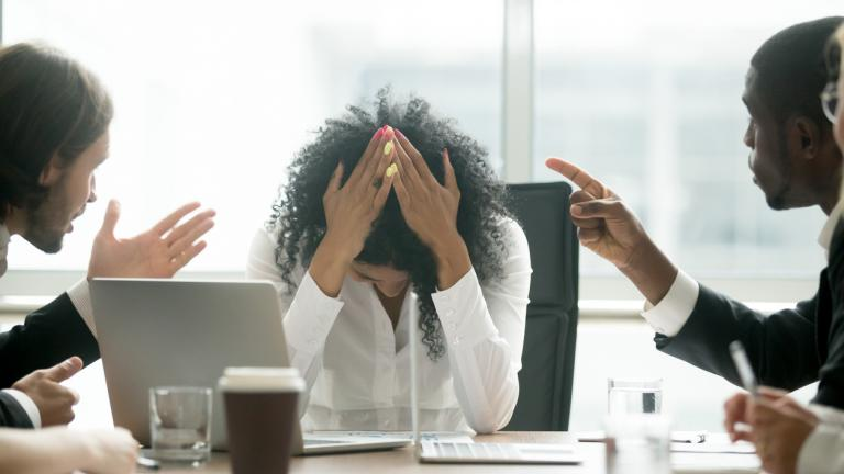 Depressed black woman leader suffering from gender discrimination at work