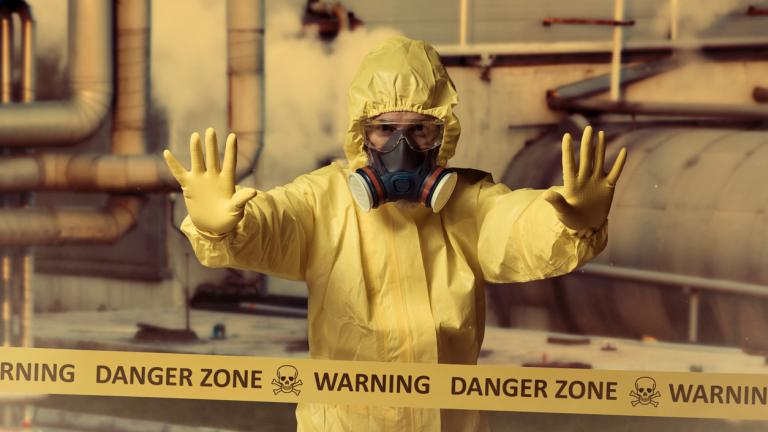 Danger zone sign, man in toxic mask