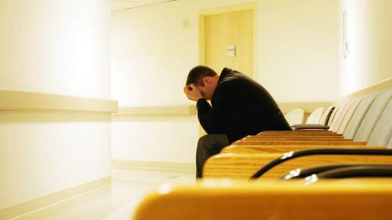 Person grieving in waiting room