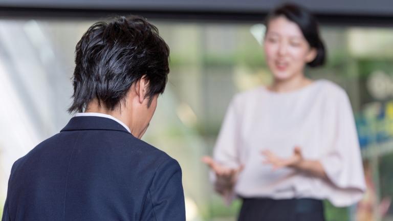 Female leader talking to male leader
