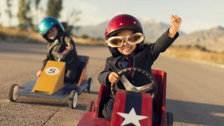 Boys racing toy cars