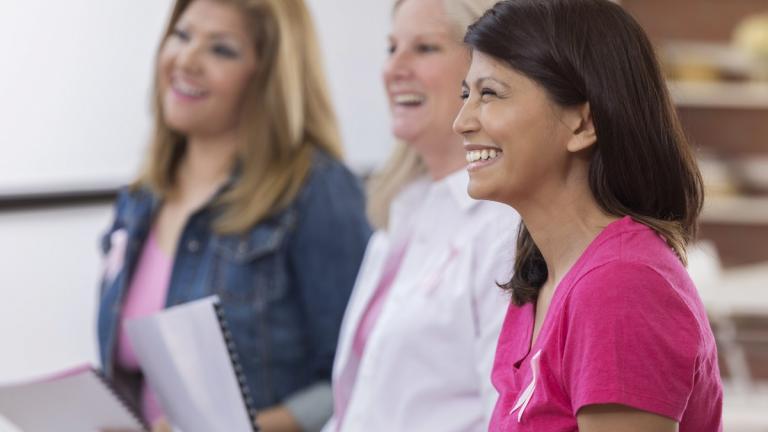 Women attending breast cancer seminar