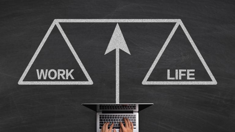 Work Life Balance Concept With Laptop On Blackboard