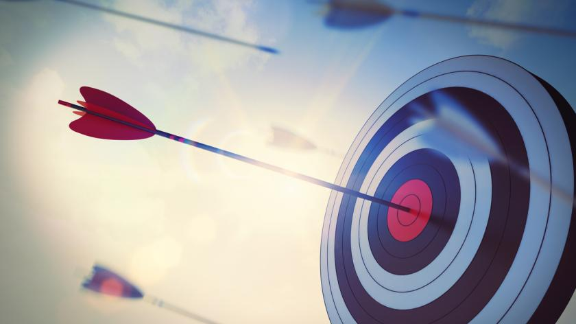 Arrow hits bullseye of dartboard