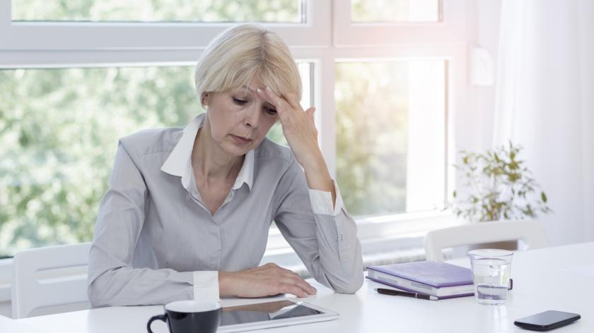 Older business woman struggling at work