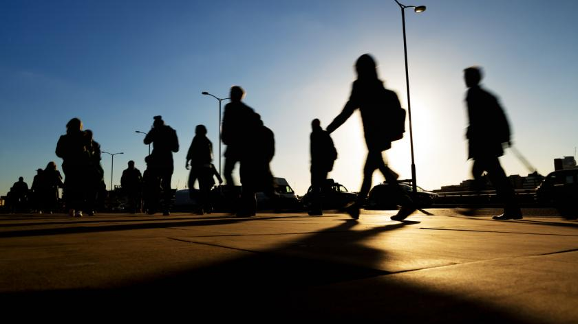 business commuters in shadow