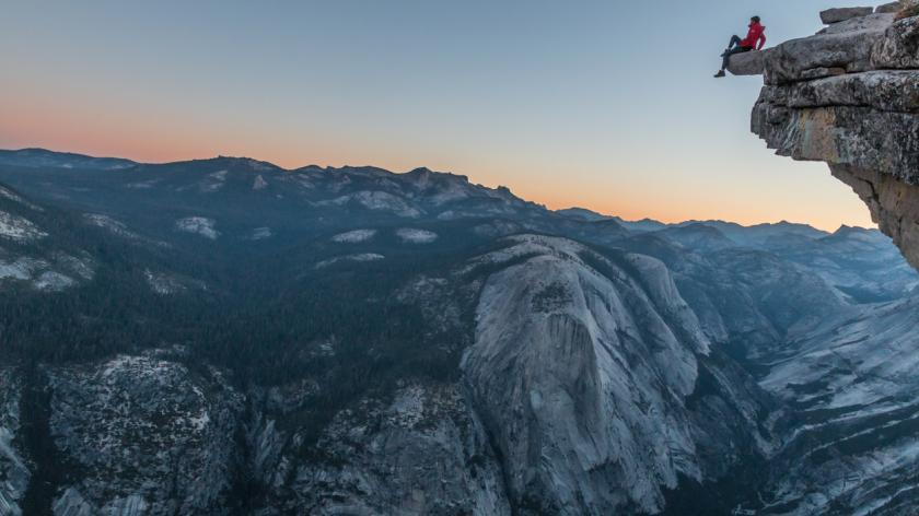 Woman sat on cliff edge