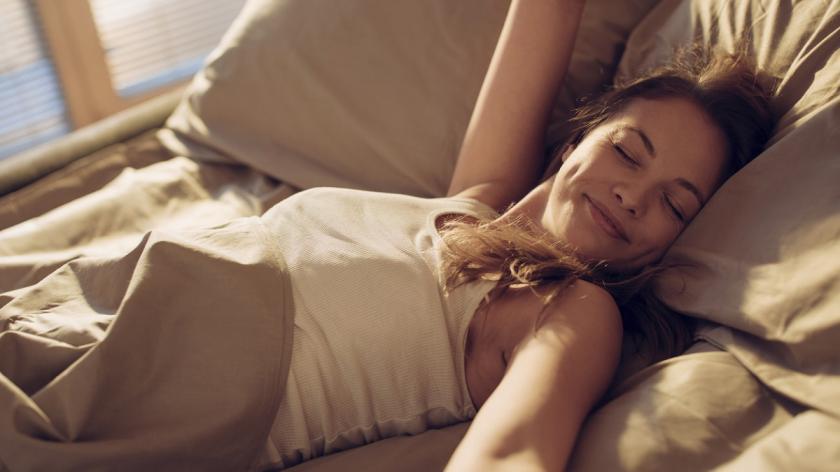 Smiling woman waking up