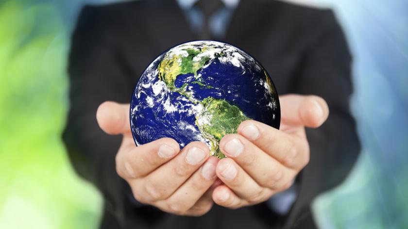 Businessman holding planet Earth