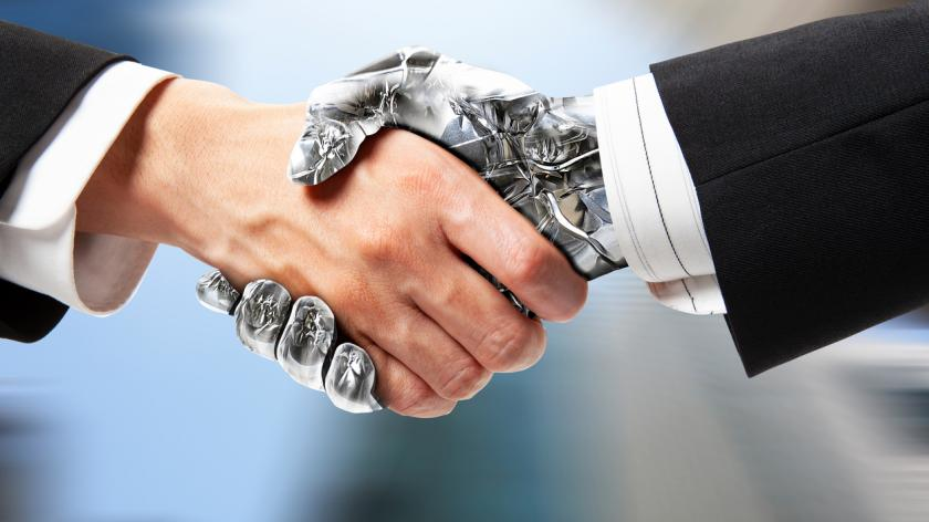 robot hand shaking a human hand