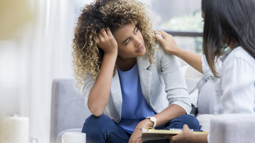 woman who is depressed at work
