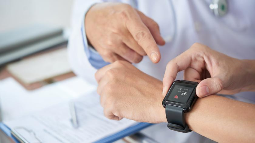 patient showing heart rate on Apple watch to doctor