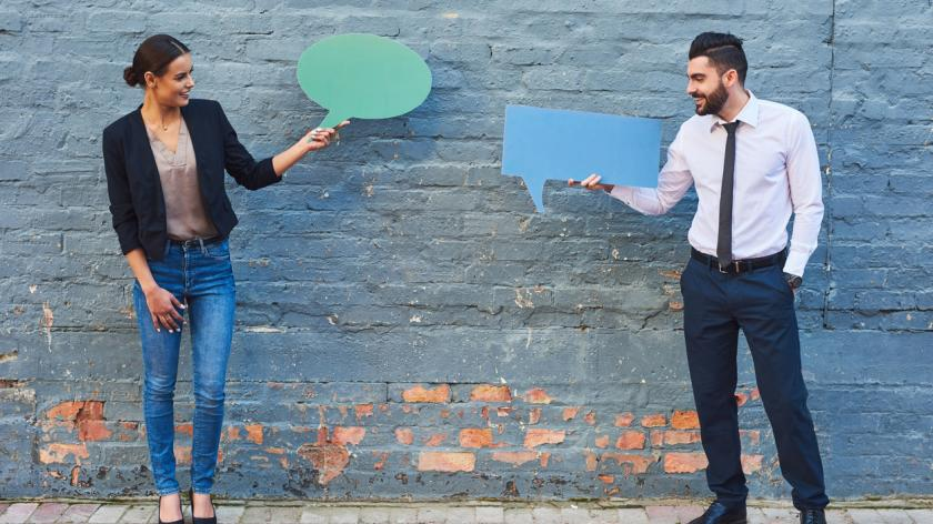 business woman and man holding speech bubbles
