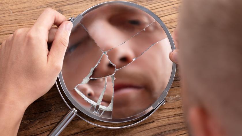 Man's Face In Broken Mirror