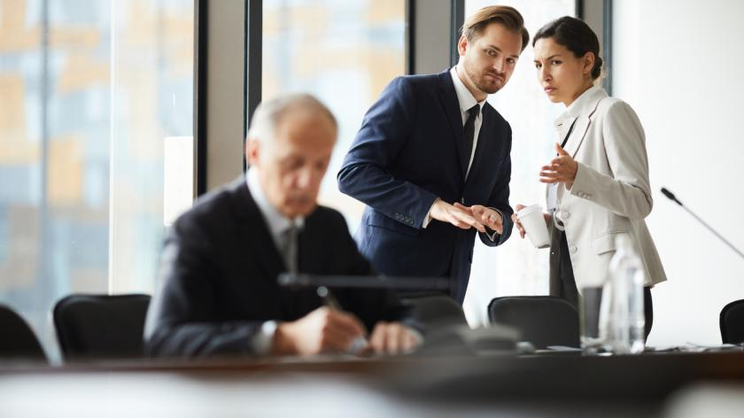 Business employees discussing boss