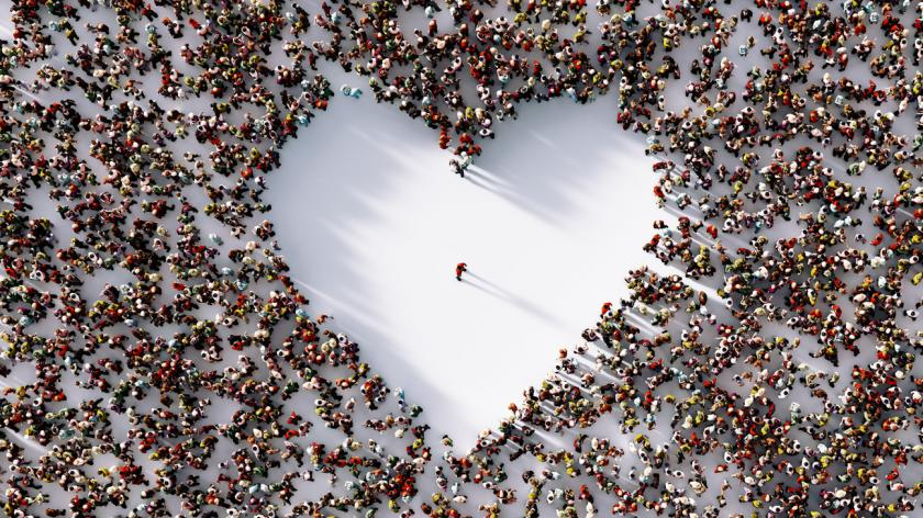 Lonely man in the middle of a white heart shaped void surrounded by people on white background.