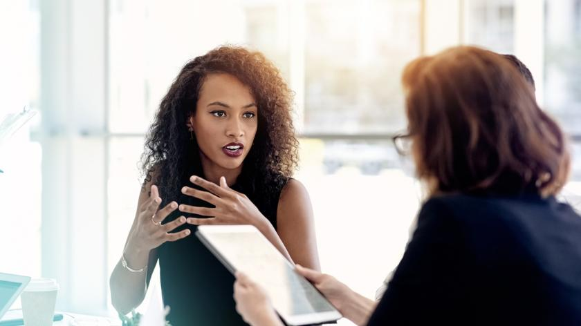 Shot of two businesswomen having a meeting in an office
