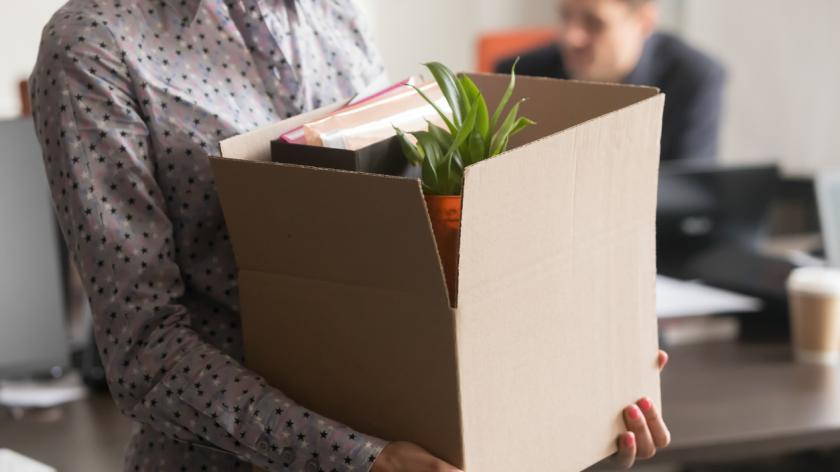 Close up view of new female employee intern holding cardboard box with belongings start finish job in company office