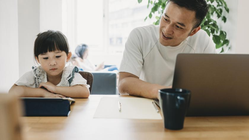 Dad working from home with child
