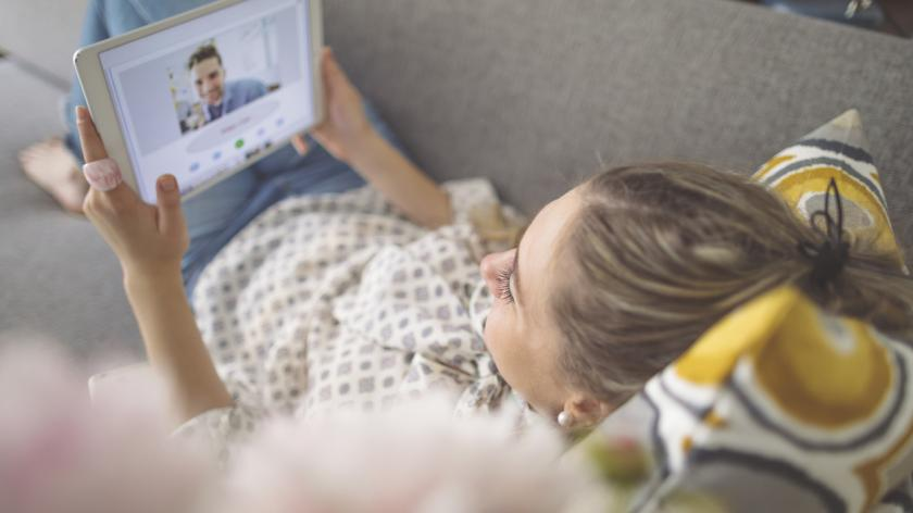 young woman on video conference from home to work