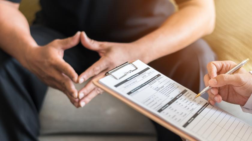 Men's health exam with doctor or psychiatrist working with patient