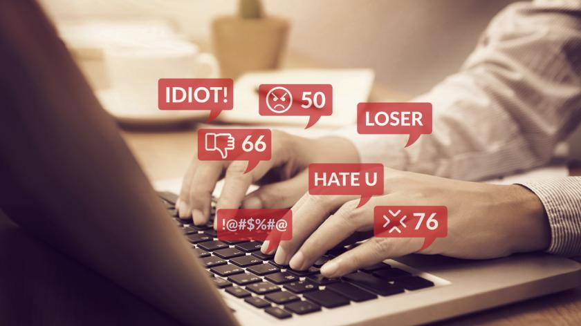 cyber bullying concept. people using notebook computer laptop for social media interactions with notification icons of hate speech and mean comment in social network