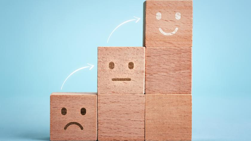 building blocks with sad face, neutral face and happy face